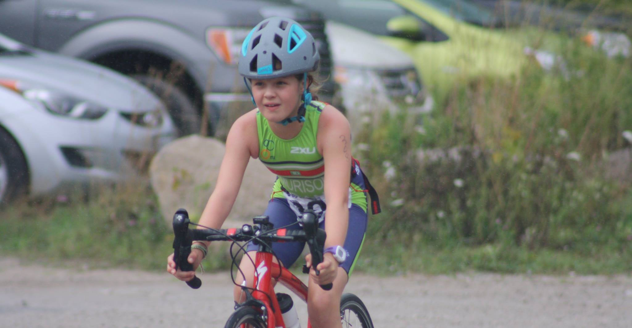 A young Peterborough Pirate Triathlon Club athlete racing her bike